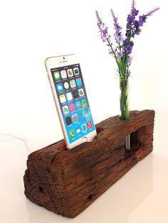 DOCK WITH INTERCHANGEABLE CORDS / CONNECTORS Wooden docking station and Bud Vase all in one. Useful, cute and decorative wood piece handmade from really unique barnwood piece. Dock has a system which allows you to easily insert or remove USB cable/cord. While using dock, cable / connector will remain still and steady in the cradle when You connecting or disconnecting a phone/device, whether You use older 30pin connector or new Lightning. >>>VASE Installed glass tu...