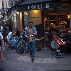 """Paris: A band plays music in front of a cafe as part of the 32nd edition of the music event """"Fete de la musique"""" on June 21, 2013. The music celebration day takes place in the streets of France's towns every year since 1982 on the first day of summer. Photo by MATTHIEU ALEXANDRE. #Fetedelamusique #Paris #France #Culture #Music #Cafe #comissioncontentgroup http://comissioncontent.com"""
