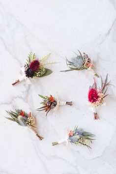Autumn boutonnières. Pastel and bold wild flowers combined.