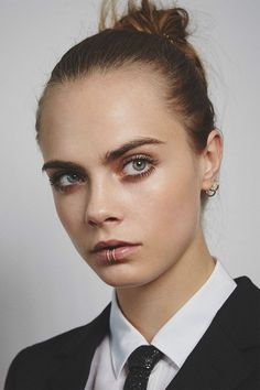 Be it glamorous ponytails, easy-to-copy up-dos or a glossy blow-dry, we chart Cara's best beauty looks