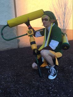 "Entry #048: Michael Leech  Character: ""Link Inkling"" (crossover of Inkling from Splatoon and Link from The Legend of Zelda) Cosplayer page: Maikeru Cosplay & Gaming  Vote for this entry by liking, commenting, and sharing this post! Contest Details: https://www.facebook.com/MiccostumesCosplayShop/posts/996975130341783"