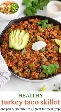 Healthy turkey taco skillet made in one pan and ready in 30 minutes! Made with ground turkey, rice, black beans, tomatoes, peppers, garlic, onion, and taco seasoning, it makes an easy and delicious meal the whole family will love. Saves great for leftovers and meal prep too! - Eat the Gains #groundturkey #turkeyrecipe #tacos #glutenfreerecipes #turkeyandrice #healthyrecipes
