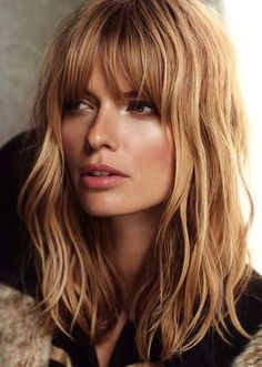 Light beachy waves and full bangs. Bangs with shoulder length hair.  Medium hairstyles look great with the right bangs.  These eyebrow skimming bangs are slightly parted.