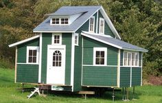 Tiny Mobile House Expands To 420 Square Feet! The side rooms fold out! So cool. See the video at the link!