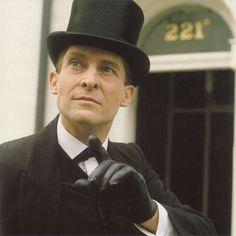 Jeremy Brett as Sherlock Holmes. Pictured here outside 221b Baker Street
