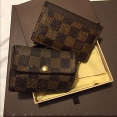 Authentic Louis Vuitton Damier Ebene Accessories Authentic Louis Vuitton Damier Ebene Accessories: Coin purse and cardholder with tags, one box and dust cover. The card holder is NWT and the coin purse is in EUC. See individual listings for dimensions and detailed pictures Louis Vuitton Bags Wallets