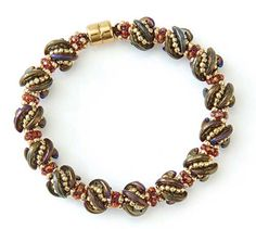 Whirligig Bracelet by Kassie Shaw. Crescent beads in a combination of CRAW and Tubular herringbone stitches.  PDF tutorial available at this site:  http://www.interweave.com/store/whirligig-bracelet