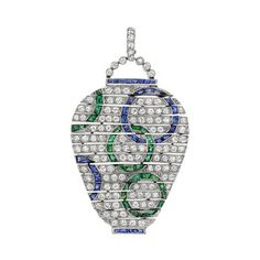 Art Deco gem-set flexible drop pendant, designed to resemble an Oriental vase, with circular-cut diamonds throughout, accented by gem-set circle motifs in calibre-cut sapphires and emeralds, mounted in platinum, circa 1920's, attributed to Van Cleef & Arpels.