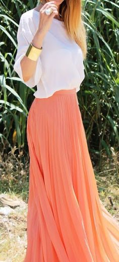Women's fashion | White top, coral pleated maxi skirt, golden bracelet