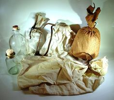 18th C. food packaging. Leather and cloth food bags plus a couple of glass bottles. Pottery was also used, but it tends to be too heavy for packing on foot. Glass although fragile, can be wrapped in cloth or covered in leather.