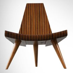 Mid 20th century Brazilian three-legged chair in five different types of Brazilian hardwood, by Joaquim Tenreiro.