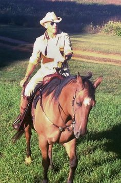 """On Bruce Springsteen's 65th birthday, his wife Patti Scialfa shared this photo of """"The Boss"""" while horseback with the caption """"happy birthday baby,"""" on Sept. 23, 2014."""