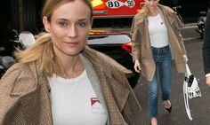 Diane Kruger makes a Parisian style statement in a chic cape coat
