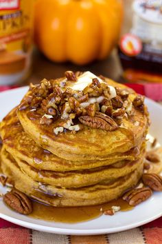You're going to love with these incredibly light and fluffy pumpkin pancakes! Perfectly spiced and topped with a homemade buttered pecan maple syrup, these golden beauties are everything I love about fall!