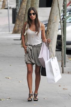 Super cute casual look. Love the blousiness of the short with the relaxed tank and boho sandals!