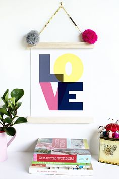 The dream way to hang precious prints: with sequins and pompoms!