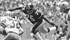 """Charles Edward Greene, known as """"Mean Joe"""" Greene, (born September 24, 1946) is a former all-pro American football defensive tackle who played for the Pittsburgh Steelers of the National Football League (NFL). . He is a member of the Pro Football Hall of Fame and a four-time Super Bowl champion. Greene is also well known for his appearance in the """"Hey Kid, Catch!"""" Coca-Cola commercial in 1979, widely considered to be one of the best television commercials of all time."""