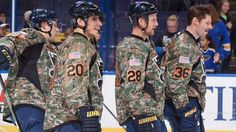 Alexander Steen, Kyle Brodziak and Troy Brouwer of the St. Louis Blues look own during warm-up prior to playing against the Buffalo Sabres on November 19, 2015 at Scottrade Center in St. Louis, Missouri.