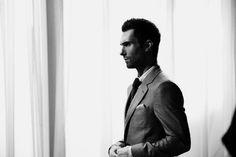 Adam Levine, in a suit