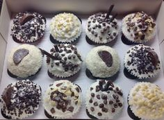 Red velvet dark chocolate and buttercream, chocolate orange. Lemon and coconut, marshmallow and amaretto cupcakes