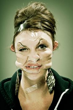 Scotch Tape Portraits. Disturbing but definitely original...