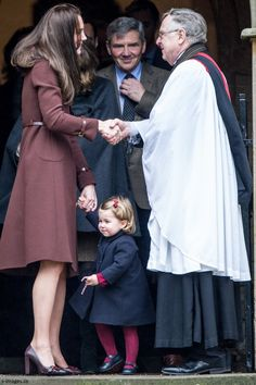 hrhduchesskate:  Christmas Service, St Mark's, Englefield, December 25, 2016-Duchess of Cambridge shakes hands with the Rev. Nick Wynne-Jones, as her father Michael Middleton looks on and her daughter Princess Charlotte, candy cane in hand, is ready to leave