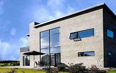 uderum haverum baksarkitekter baks arkitekter facade arkitekttegnet villa vinduesparti kubisme dobbelthøjt rum tagterrasse terrasse
