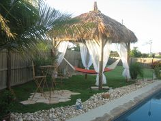 What a way to relax.  a hammock under a waterproof tiki hut.