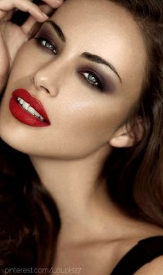 If you're going to do a red lip with a smoky eye, make sure you're using brown or grey..black will Be too harsh
