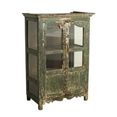 Green cabinet - We travel through India to find to most beautiful and unique cabinets. Without losing the story of their past we fix the cabinets where necessary, while keeping them as original as possible. Our mission is to pass them on to a new home where they will be appreciated for many years to come.