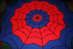 Superhero Round Ripple Afghan I made for my grandson, Chayce.  Hard to find crochet for boys but he loved this one.