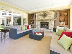 Open plan living room using cream colours with carpet & exposed eaves - Living Area photo 246867