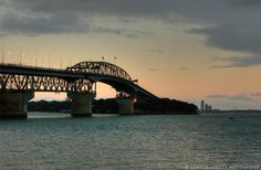 Auckland NZ harbor bridge. Get tips for honeymoon in New Zealand