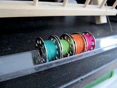 Organize your bobbins with a corner guard from  the hardware store. Clever idea from Sew Many Ways.