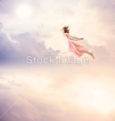 Girl in a pink dress flying in the sky