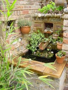 Lovely water feature fr a compact garden.