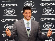 After a warm New York welcome, Tim Tebow flashes a friendly smile Monday while taking questions at his New York Jets news conference in Florham Park, N.J. We'll miss you in Denver Timmy!!