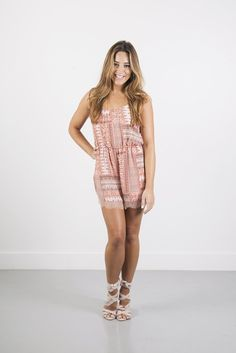 2ca3b5570e0 Sweet shoulder ties and a scallop lace trim up the feminine wiles of this  pretty crepe romper. V-neckline neckline. Double scallop lace trim at  shorts.