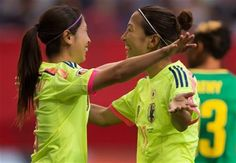 Japan's Aya Sameshima, left, and Yuki Ogimi celebrate Sameshima's goal against Cameroon during the first half of a FIFA Women's World Cup soccer match Friday, June 12, 2015, in Vancouver, British Columbia, Canada. (Darryl Dyck/The Canadian Press via AP) ▼10Jun2015AP|Japan earns knockout berth with 2-1 win over Cameroon http://bigstory.ap.org/article/6da7cc6c61a440d09f80e45330b33a21 #2015_FIFA_Womens_World_Cup #Group_C_Japan_vs_Cameroon #鮫島彩 #大儀見優季