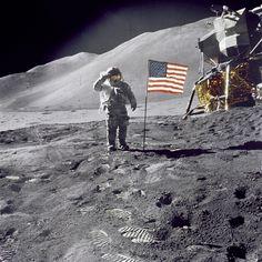 Astronaut David Scott salutes.