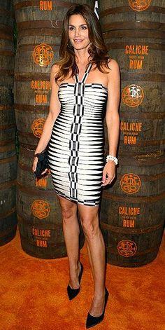 Who made Cindy Crawford s black and white print halter dress  Dress – Hervé  Léger by b322ffd79