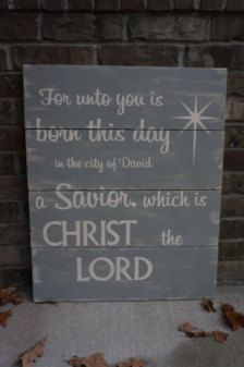 a savior is born - distressed wood sign
