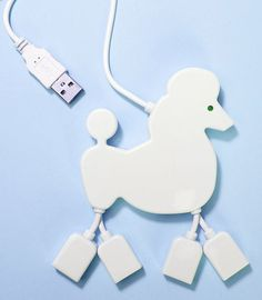 Poodle-Shaped USB Hub($16) uses the dog's legs as ports, and and its eyeball lights up when it's in use. Cool design.