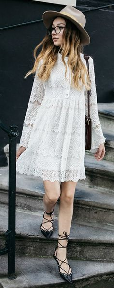 Beatrice Gutu + oozes femininity + beautifully intricate white lace dress + button up detailing + patterned hem + hat + strappy sandals + wonderful style!  Dress: Zimmermann.