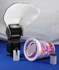 DIY lighting equipment - includes a cool idea for a DIY reflector made from metalic card.  http://mgreerphoto.blogspot.co.uk/2007/03/diy-lighting-equipment_17.html