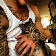 This is so adorable. I don't really care for cats but wat man with tats aka tht tough look is gonna be cuddled up with a kitten?