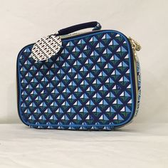 """TORY BURCH limited edition lunch box makeup bag Exuberantly printed geometric canvas exterior with scattered Tory Burch T logos. Antimicrobial lining is easy to wipe clean. Two-way zip-around top with one Tory Burch signature medallion pull. 10.25""""W x 3.25""""D x 7.75""""T.  Could be used as travel cosmetics bag as well.  ***There is a small hole at the handle covering-this was there at purchase. Protective covering is still on logo zippers. This Tory Burch set originally came with thermos. This…"""