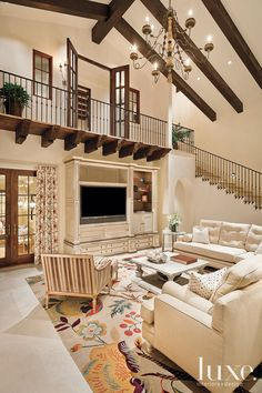 A vibrant rug adds a splash of color to an Arizona Spanish Colonial's livingroom.