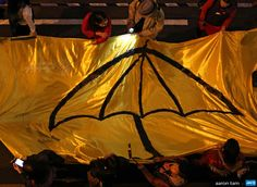 CHINA, HONG KONG : Protesters carry a long yellow banner during a march with an umbrella – a recent symbol of Hong Kong's democracy movement – painted on it during a march to mark Christmas Eve on December 24, 2014. The city's democracy campaigners took to the streets in the first large rally after pro-democracy protest camps, which occupied major streets for over two months, were swept away. AFP PHOTO / AARON TAM