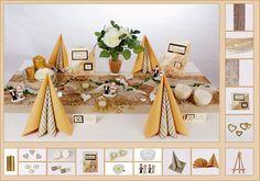 Die Tischdekoration zur Goldenen Hochzeit in Dune wirkt edel und stilvoll. Goldene Herzen, ein Brautpaar und weiße Rosen sorgen für die Akzente.